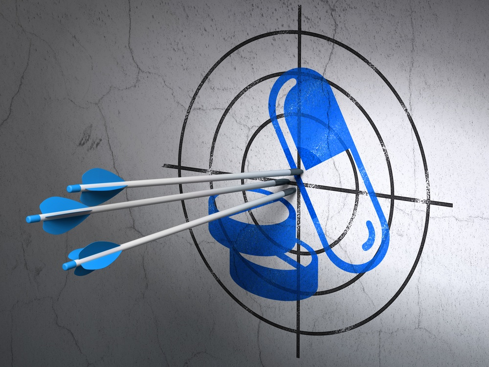 arrows hitting the center of Blue Pills target on wall
